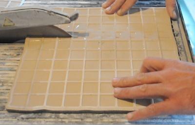 découpe de carrelage à la scie à eau